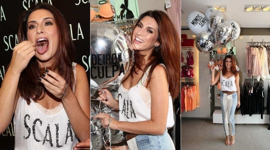 """9.mar.2013 - Fernanda Paes Leme prestigiou o lançamento de uma coleção de roupas femininas em São Paulo. A atriz de 'Salve Jorge"""" se deliciou com um brigadeiro"""