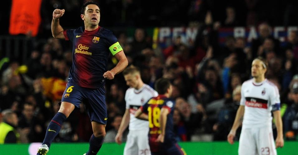12.03.2013 - Xavi pula para comemorar gol do Barcelona no duelo contra o Milan pela Liga dos Campeões