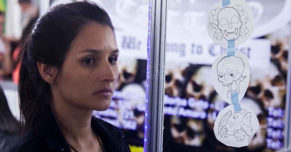 23.mar.2013 - Mulher participa da 8ª edição da São Paulo Tattoo Festival, convenção de tatuagem que reúne artistas e admiradores no centro de São Paulo, neste sábado (23) e domingo (24)