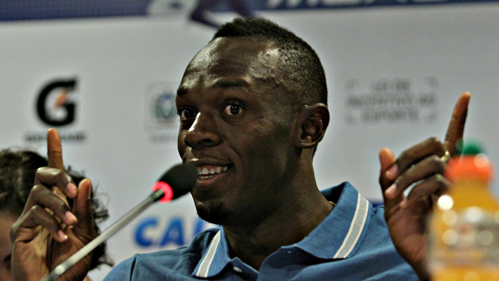 28.mar.2013 - Usain Bolt sorri durante coletiva de imprensa no Rio de Janeiro