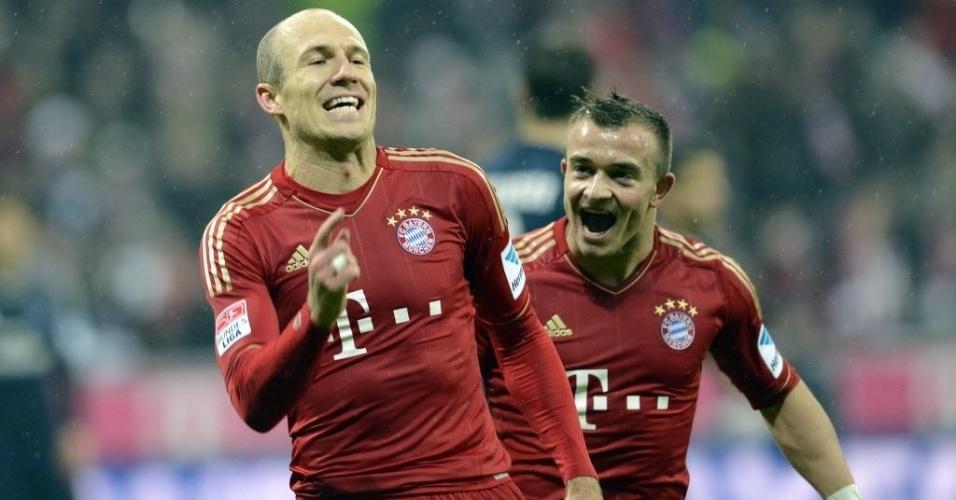 30.mar.2013- Robben comemora o quarto gol do Bayern de Munique, na goleada sobre o Hamburgo, pelo campeonato alemão