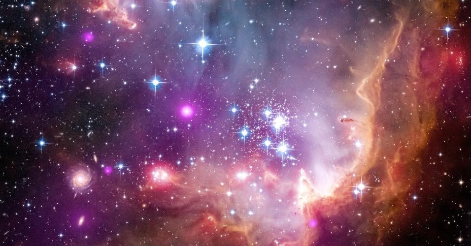 3.abr.2013 - Astrônomos detectam pela primeira vez emissão de raio-x por jovens estrelas com massas similares a do nosso Sol fora da Via Láctea, usando o observatório Chandra. A observação foi feita na Pequena Nuvem de Magalhães, a  210 mil anos-luz de distância, uma das mais próximas a nossa e considerada uma galáxia anã, mas também é muito brilhante, o que permite que seja observada a olho nu da Terra