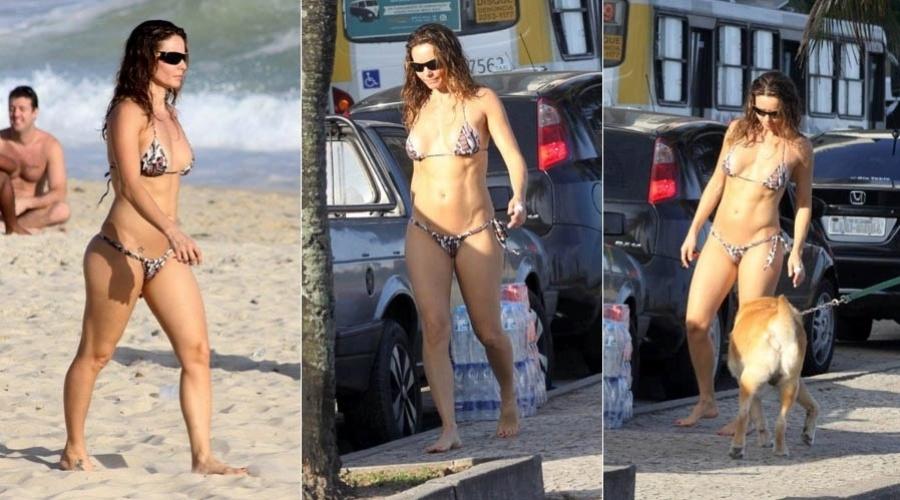 7.abr.2013 - De biquíni, Rita Guedes exibe boa forma na praia do Leblon