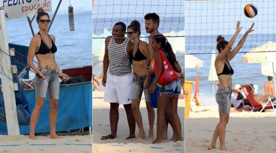 7.abr.2013 - Fernanda Lima e Rodrigo Hilbert posam ao lado de fãs na praia do Leblon