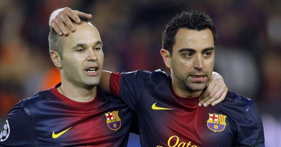Iniesta e Xavi comemoram classificação contra o PSG