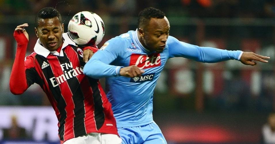 14.abr.2013 - Titular, Robinho disputa bola com o colombiano Zuñiga na partida entre Milan e Napoli