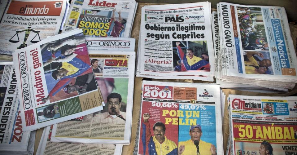 15.abr.2013 - Jornais destacam a vitória do candidato chavista Nicolás Maduro, nesta segunda-feira (15). Maduro será o sucessor de Hugo Chávez, morto há pouco mais de um mês