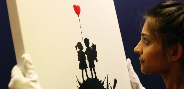 "O quadro ""Kids On Guns Hill"", assinado por Banksy - Olivia Harris/Reuters"