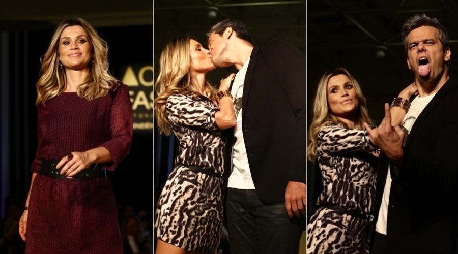 24.abr.2013 - Flávia Alessandra e Otaviano Costa desfilaram em um evento de moda em São Paulo. O casal trocou beijos na passarela