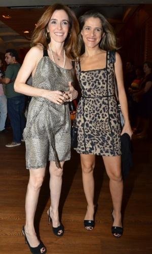29.abr.2013: Débora Evelyn e Ingrid Guimarães chegam juntas à festa