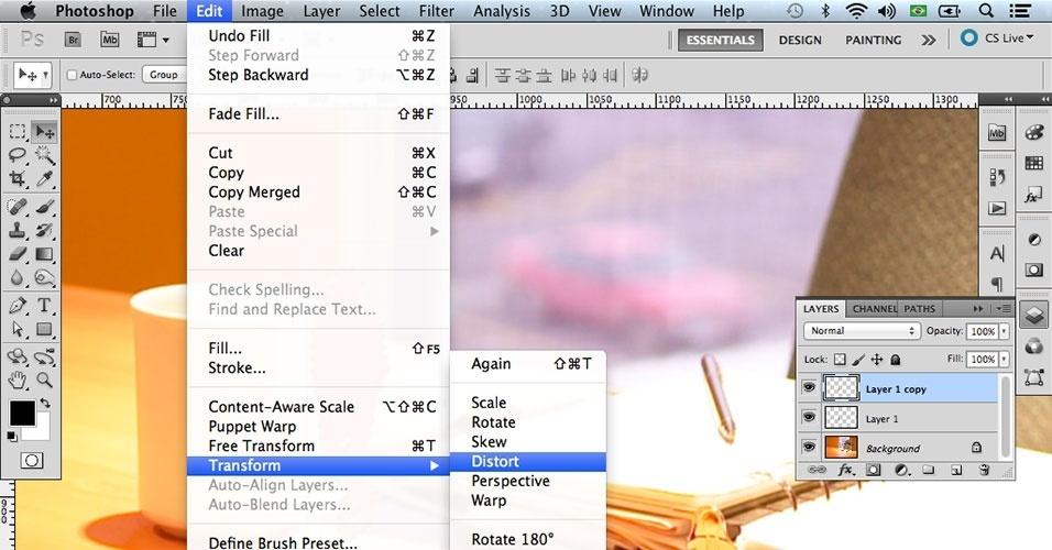 Volte à Move Tool (Ferramenta Mover) e depois vá em Edit > Transform > Distort (Editar > Transformação > Distorcer)