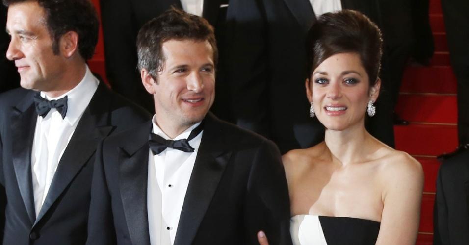 20.mai.2013 - O diretor Guillaume Canet e a atriz Marion Cotillard após apresentação do filme