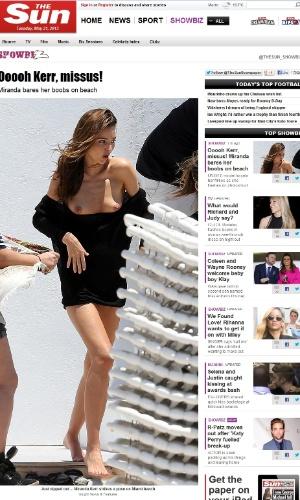21.mai.2013 - Miranda Kerr se descuida e mostra os seios em ensaio fotográfico em Miami