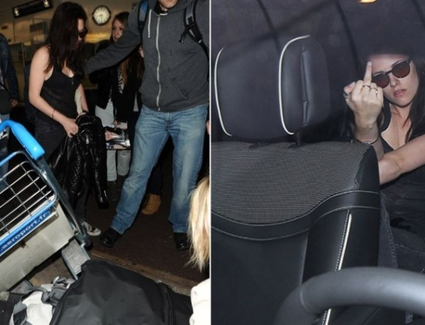 23.mai.2012 - A caminho do Festival de Cannes, a atriz Kristen Stewart perde a paciência no aeroporto de Nice, na França, deixa as malas cairem do carrinho e, dentro de um carro, mostra o dedo médio para os fotógrafos