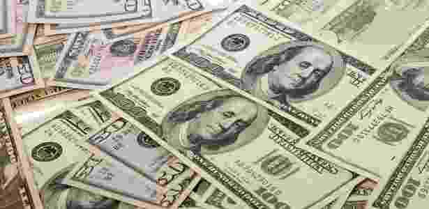 Notas de dólar - Shutterstock - Shutterstock