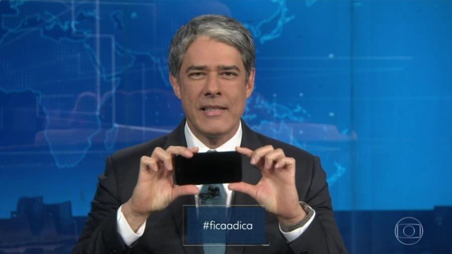 Willian Bonner ensina telespectadores a filmar com o celular para participar de campanha - Reproução / TV Globo