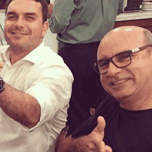 O senadro Flávio Bolsonaro e seu ex-assessor Fabrício Queiroz - Reprodução