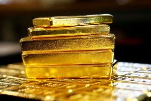 Novos ricos do bitcoin apostam no ouro após queda da criptomoeda (Foto: Leonhard Foeger/Arquivo/Reuters)