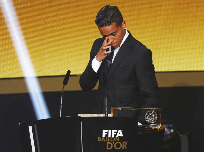Goiano's Wendell Lira of Brazil reacts after receiving the Puskas Award for Best Goal during the FIFA Ballon d'Or 2015 ceremony in Zurich, Switzerland, January 11, 2016. REUTERS/Arnd Wiegmann