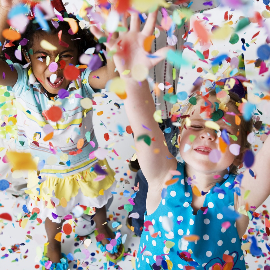Children Playing in Confetti