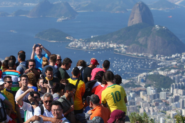 RIO DE JANEIRO, BRAZIL - JUNE 09: Tourists take photos of the view by the Christ Redeemer Statue on June 9, 2014 in Rio de Janeiro, Brazil. (Photo by Julian Finney/Getty Images)