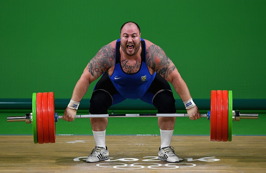 RIO DE JANEIRO, BRAZIL - AUGUST 16: Fernando Saraiva Reis of Brazil competes during the Men's +105kg Weightlifting contest on Day 11 of the Rio 2016 Olympic Games at Riocentro - Pavilion 2 on August 16, 2016 in Rio de Janeiro, Brazil. (Photo by Matthias Hangst/Getty Images)