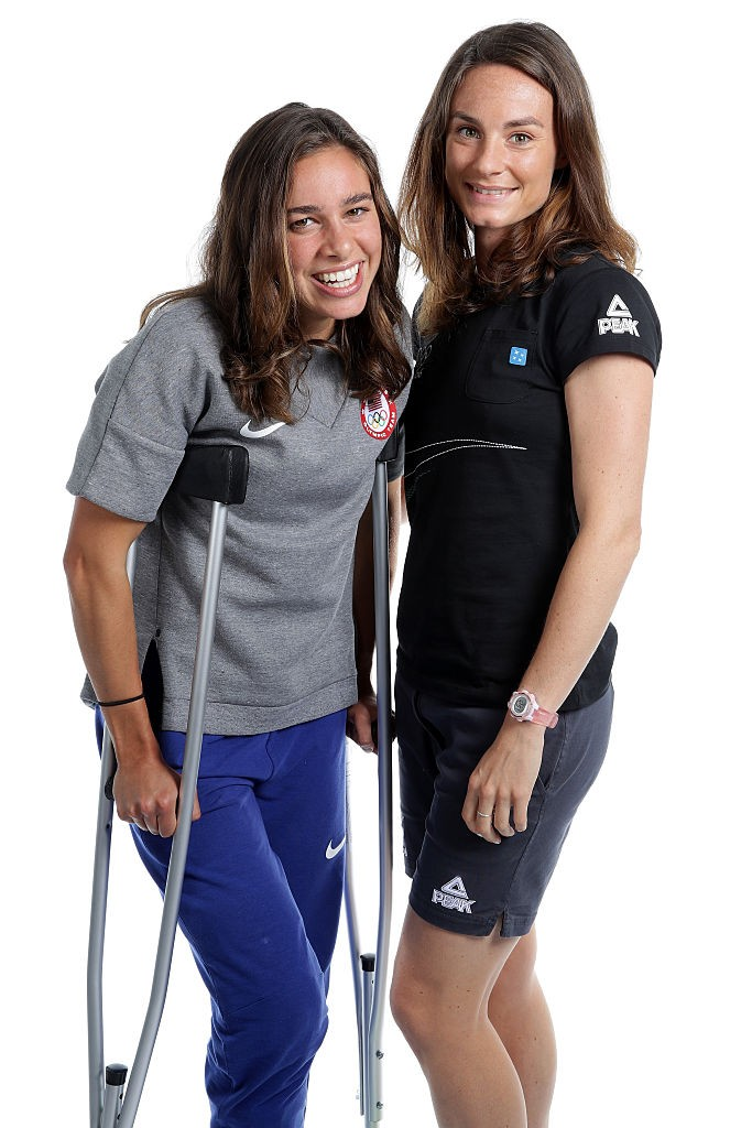 RIO DE JANEIRO, BRAZIL - AUGUST 17:  New Zealand distance runner, Nikki Hamblin and American runner, Abbey D'Agostino pose for a portrait on August 17, 2016 in Rio de Janeiro, Brazil. Hamblin and D'Agostino came last in their 5000m heat on Tuesday after they collided and fell midway through their race. The pair have been commended for their sportsmanship after they helped each other up to finish the race.  (Photo by Chris Graythen/Getty Images)