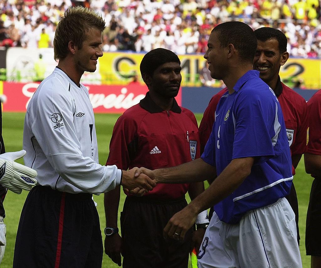 SHIZUOKA - JUNE 21: David Beckham (left) of England and Ronaldo (right) of Brazil shake hands before the England v Brazil World Cup Quarter Final match played at the Shizuoka Stadium Ecopa in Shizuoka, Japan on June 21, 2002. Brazil won the match 2-1. (Photo by Stu Forster/Getty Images)