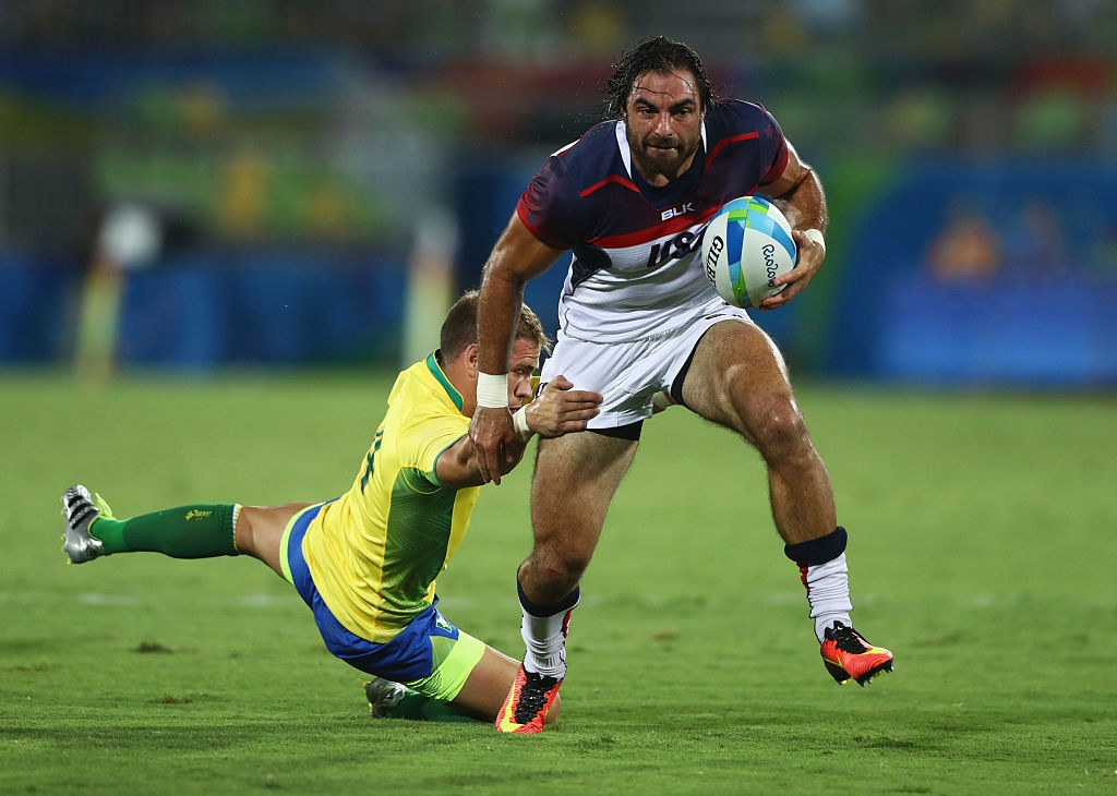 RIO DE JANEIRO, BRAZIL - AUGUST 09:  Nate Ebner of the United States beats Felipe Claro of Brazil to score a try during the Men's Rugby Sevens Pool A match between the United States and Brazil on Day 4 of the Rio 2016 Olympic Games at Deodoro Stadium on August 9, 2016 in Rio de Janeiro, Brazil.  (Photo by David Rogers/Getty Images)
