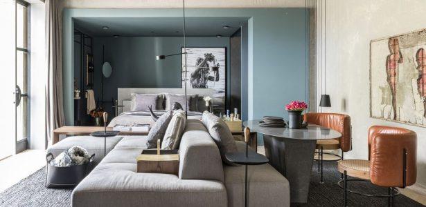 Como utilizar um sofá-ilha para dividir os ambientes em casa