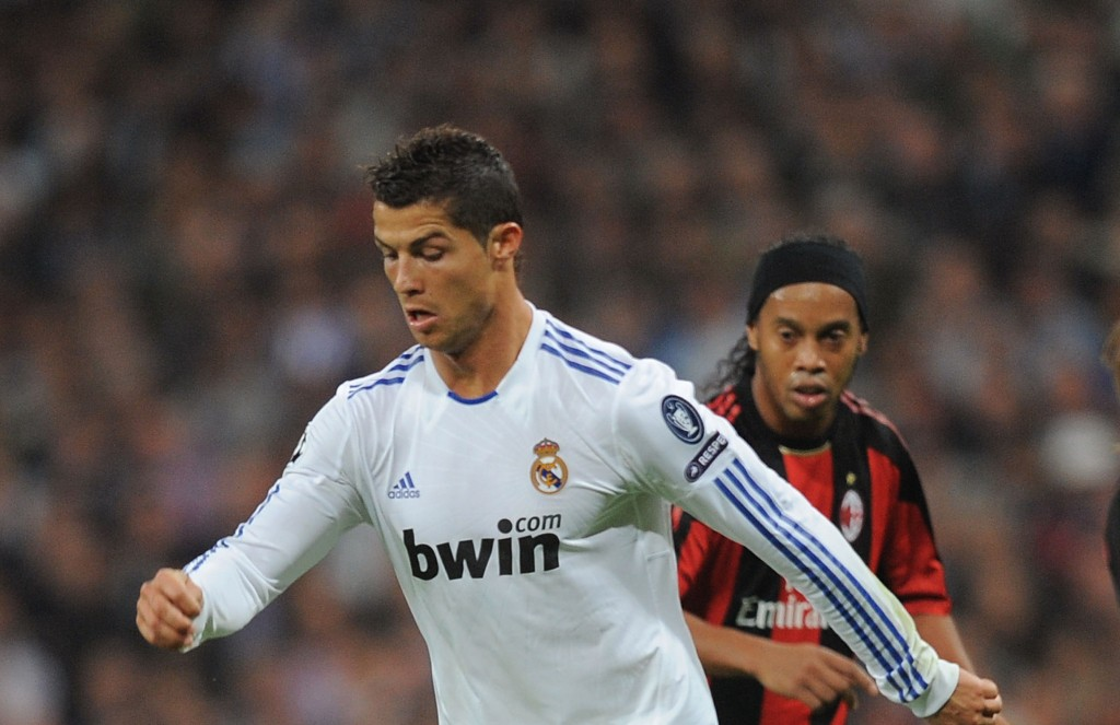 MADRID, SPAIN - OCTOBER 19: Cristiano Ronaldo of Real Madrid dribbles with the ball while being watched by Ronaldinho of the AC Milan during the UEFA Champions League Group G match between Real Madrid and AC Milan at Estadio Santiago Bernabeu on October 19, 2010 in Madrid, Spain. (Photo by Denis Doyle/Getty Images)