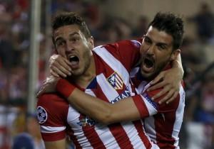 Koke e Villa comemoram o gol da classificação do Atlético de Madrid