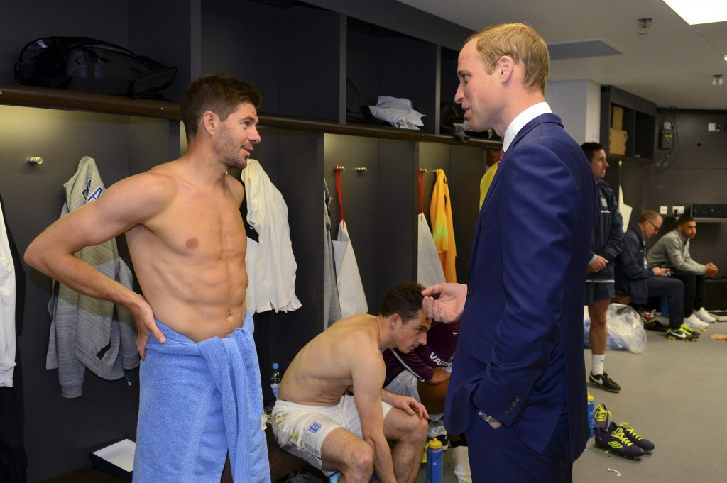 Britain's Prince William, president of The Football Association, speaks to England captain Steven Gerrard after their international friendly soccer match against Peru in London