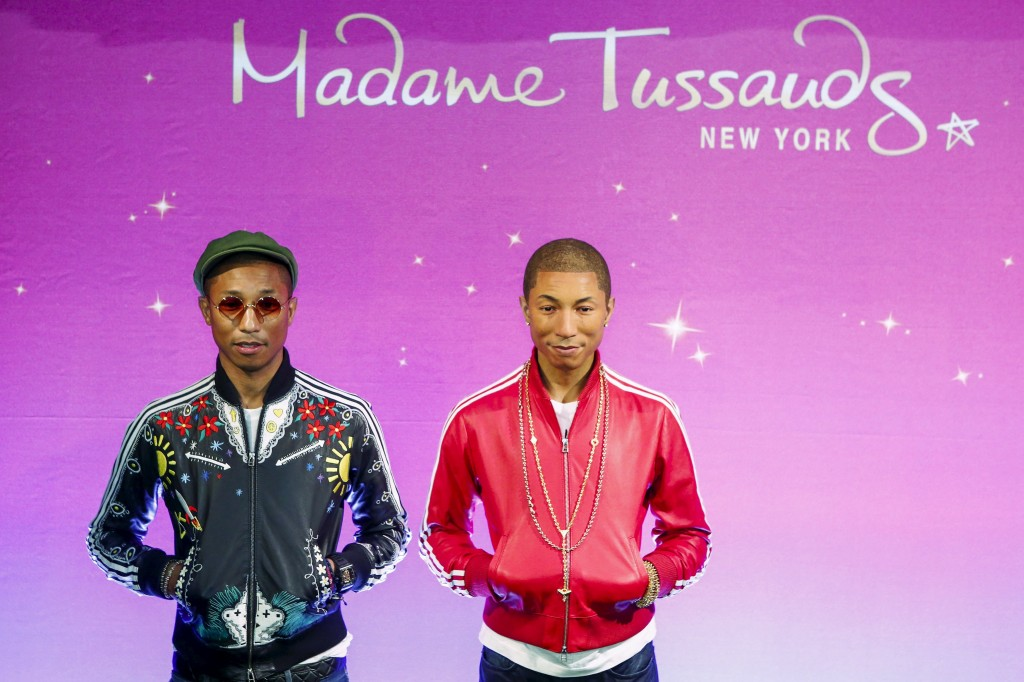 Musician Williams poses next to his wax double at Madame Tussauds in New York