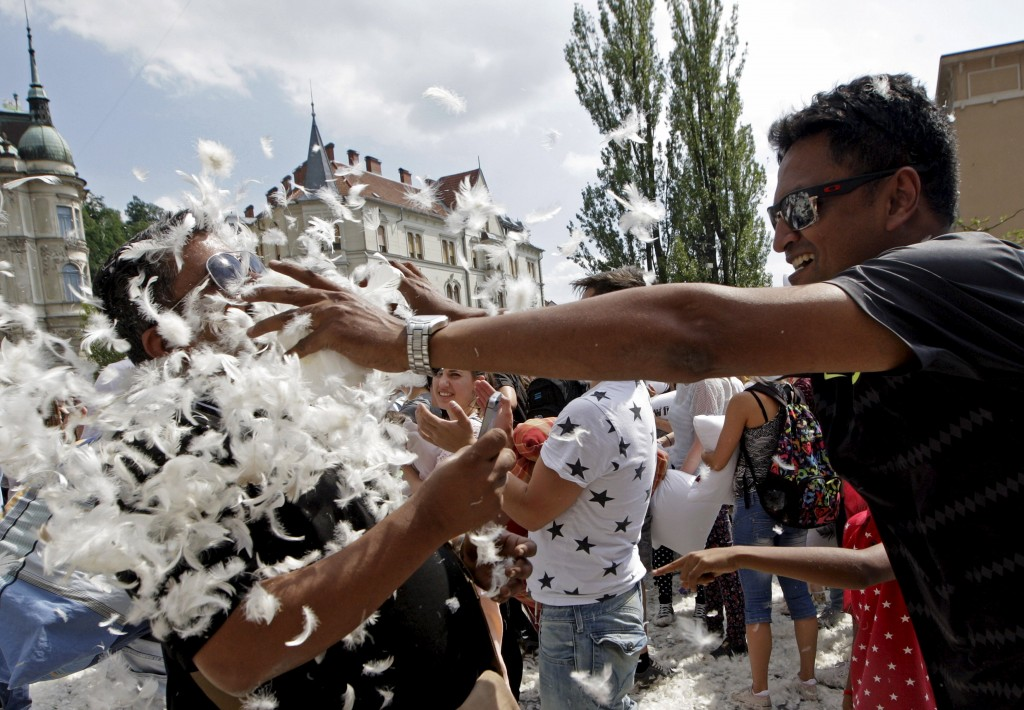 Tourists from India take part in a pillow fight in Ljubljana