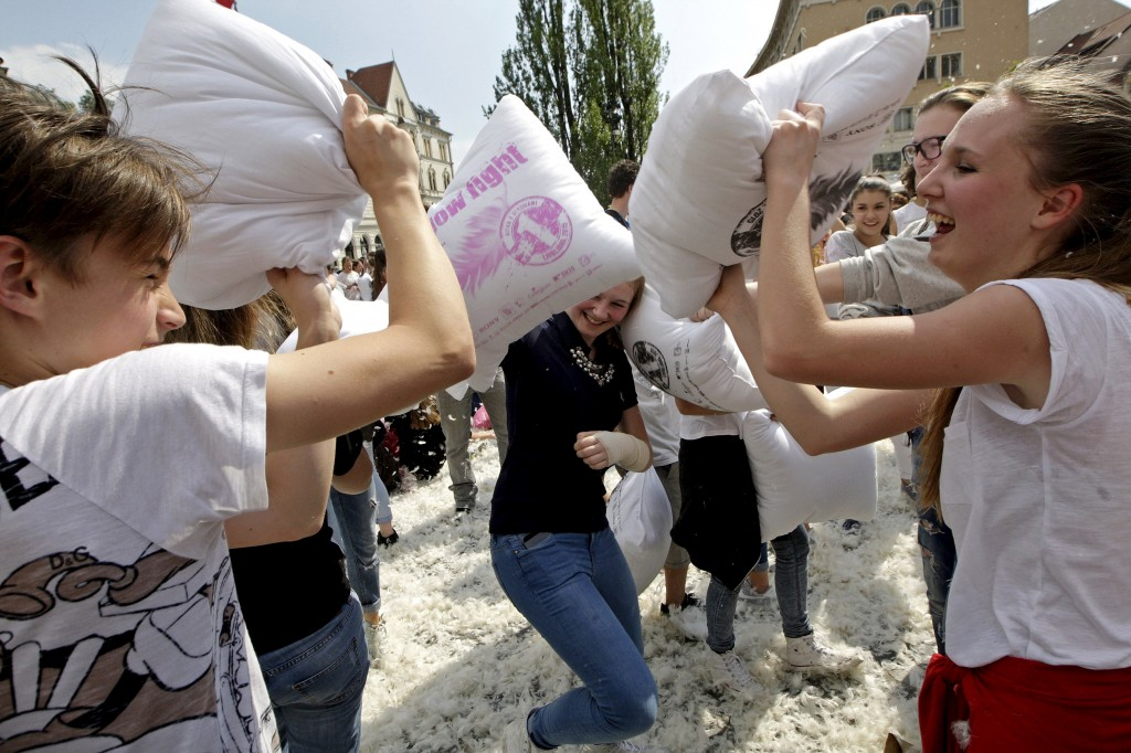People take part in a pillow fight in Ljubljana, Slovenia