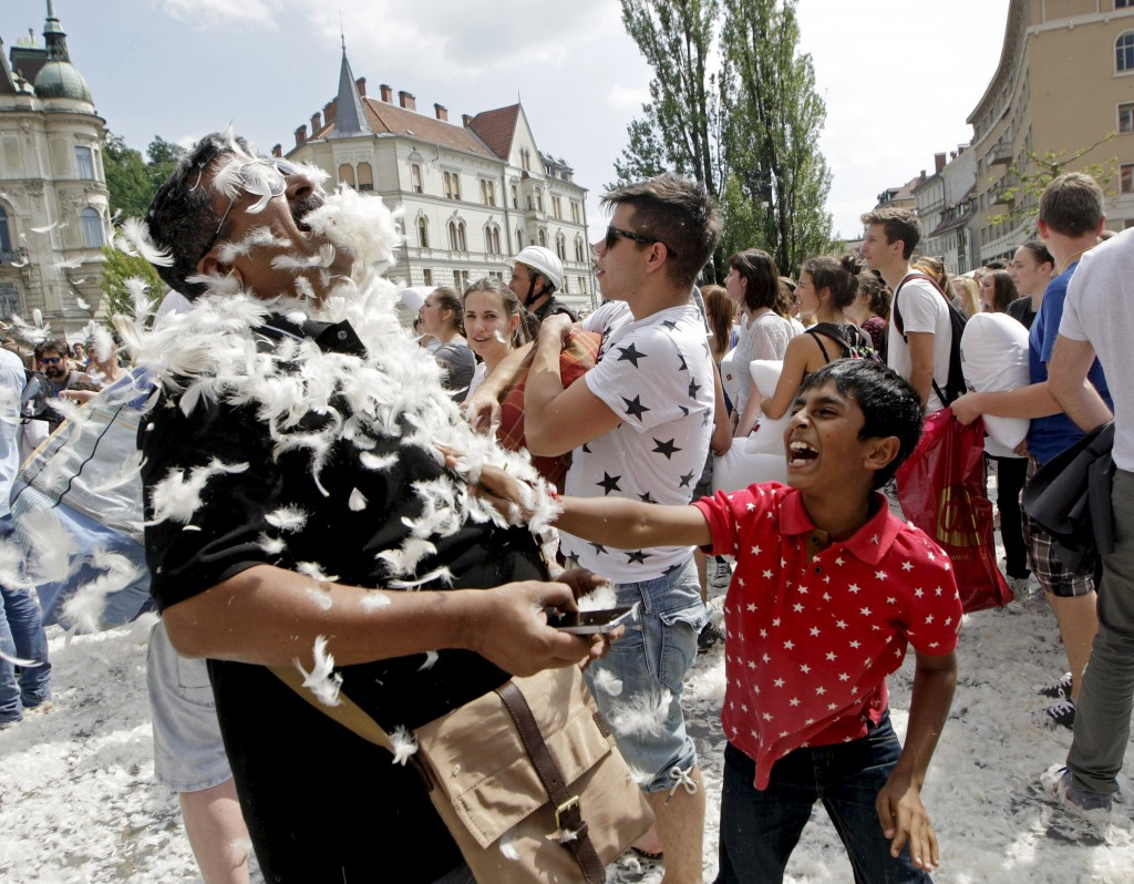 Tourists from India take part in a pillow fight in Ljubljana, Slovenia