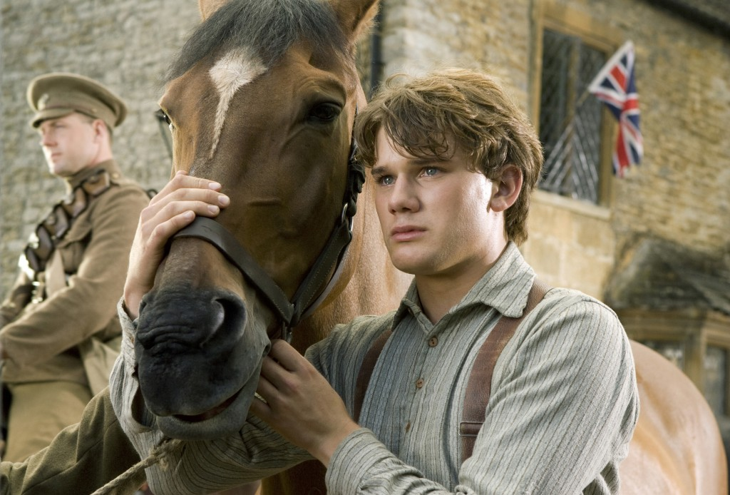 """""""WAR HORSE"""" DM-AC-00047 Albert (Jeremy Irvine) and his horse Joey are featured in this scene from DreamWorks Pictures' """"War Horse"""", director Steven Spielberg's epic adventure for audiences of all ages, set against a sweeping canvas of rural England and Europe during the First World War. Ph: Andrew Cooper, SMPSP ©DreamWorks II Distribution Co., LLC. All Rights Reserved."""