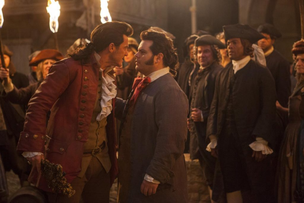 Luke Evans is Gaston and Josh Gad is LeFou, in Disney's BEAUTY AND THE BEAST, a live-action adaptation of the studio's animated classic, directed by Bill Condon.