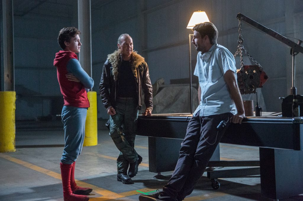 (l to r) Tom Holland, Michael Keaton, and director Jon Watts on the set of Columbia Pictures' SPIDER-MAN™: HOMECOMING.