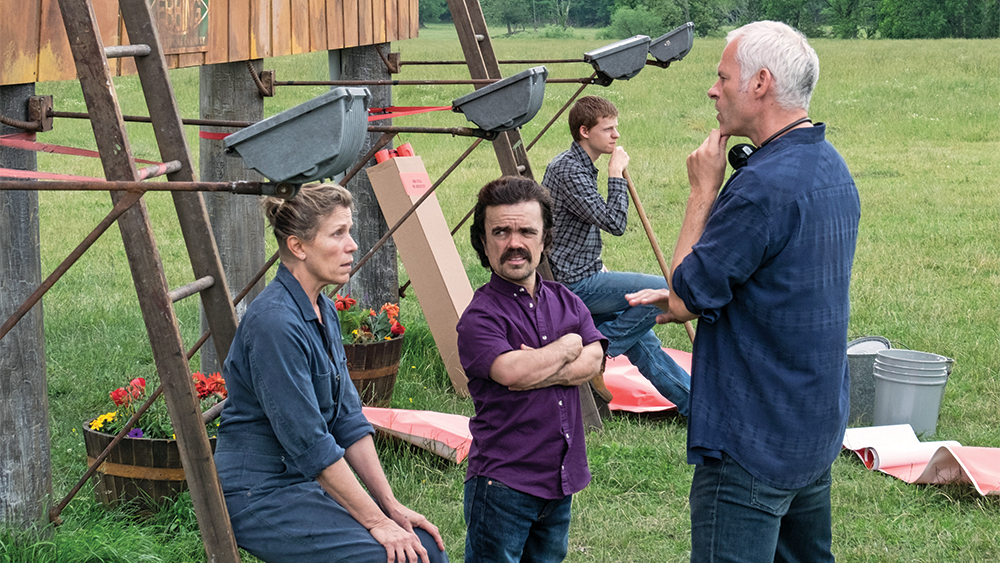 (From L-R) Actress Frances McDormand, actor Peter Dinklage and director/writer Martin McDonagh on the set of THREE BILLBOARDS OUTSIDE EBBING, MISSOURI.<br /> Photo by Merrick Morton. © 2017 Twentieth Century Fox Film Corporation All Rights Reserved