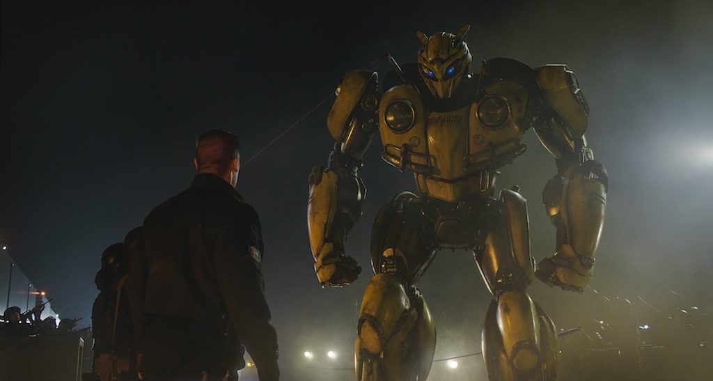 Left to right: John Cena as Agent Burns and Bumblebee in BUMBLEBEE from Paramount Pictures.
