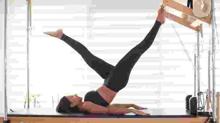 Pilates aerobic instructor woman in cadillac - iStock - iStock