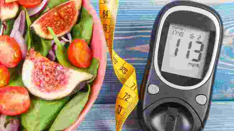 Fruit and vegetable salad and glucose meter with tape measure, concept of diabetes, slimming and healthy nutrition - iStock - iStock