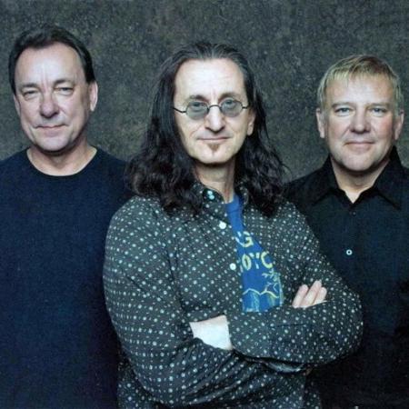 Os integrantes do Rush - hoje já não muito cabeludos - false