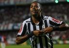 Robinho comanda virada e Atlético bate Cruzeiro em clássico no Mineirão