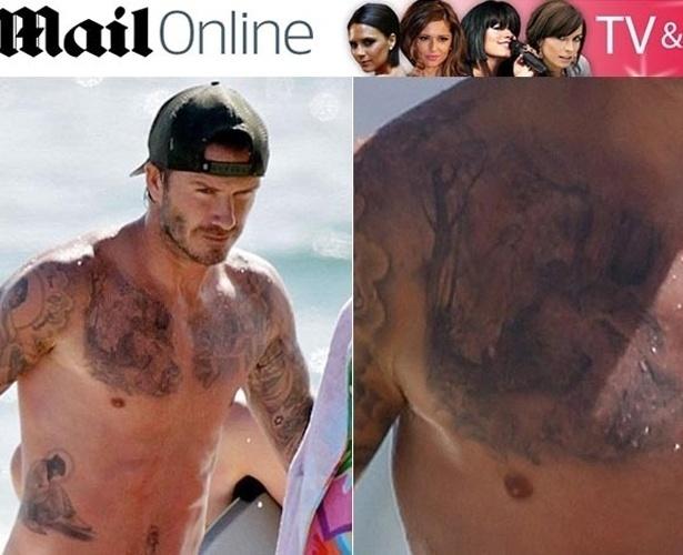 30.ago.2013 - David Beckham exibiu sua nova tatuagem em uma tarde na praia com os filhos na quinta-feira (29). Essa é a 33ª que o ex-jogador de futebol tatua seu corpo. De acordo com o jornal britânico