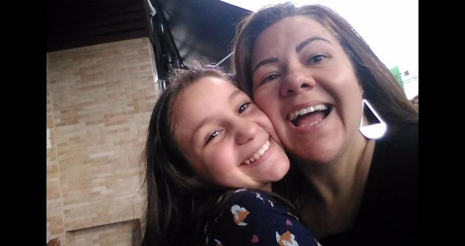 """Erivane Alencar Moreno, de São Paulo (SP), com o """"maior amor da sua vida"""": a filha Amanda"""