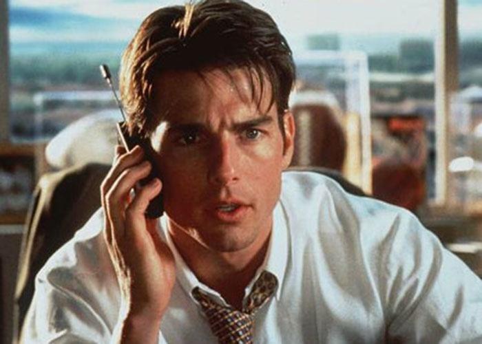 """Tom Cruise interpreta """"Jerry Maguire"""" na comédia homônima de 1996. O filme foi bem recebido pela crítica, que elogiou a atuação do ator."""
