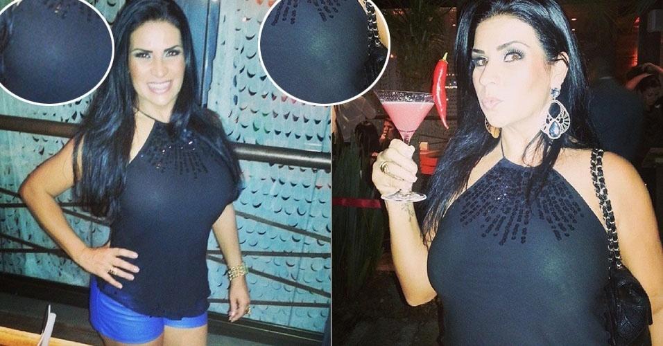 """10.set.2013 - Solange Gomes acabou mostrando demais em um evento no Rio de Janeiro durante a inauguração de um restaurante na Barra da Tijuca, na zona oeste da cidade. Com uma blusa preta e um short curtinho, ela foi traída pelo flash de seu celular e deu pra ver que a musa estava sem sutiã. """"Um drinque pensando em mim... A pimenta só não é maior que o olho gordo (risos). Adorei!"""", disse na rede social Instagram"""